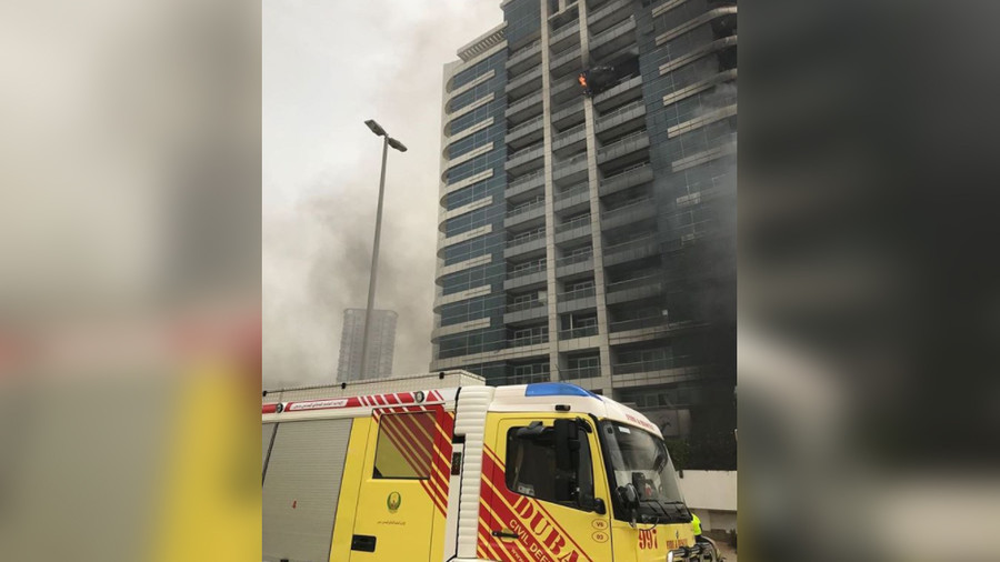 Massive fire erupts in high-rise building