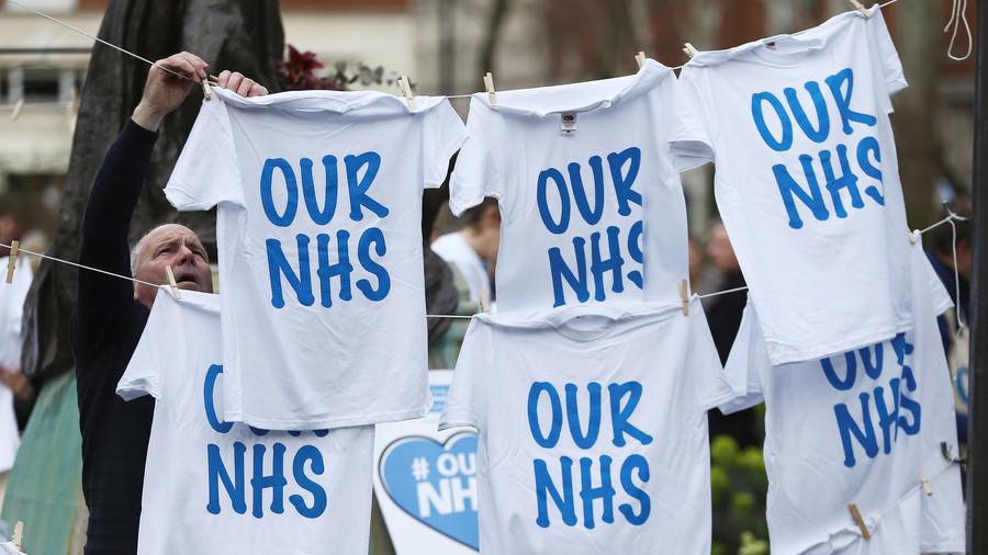 May tells public to 'celebrate' privatization in NHS as Hawking campaign hits high court (VIDEO)