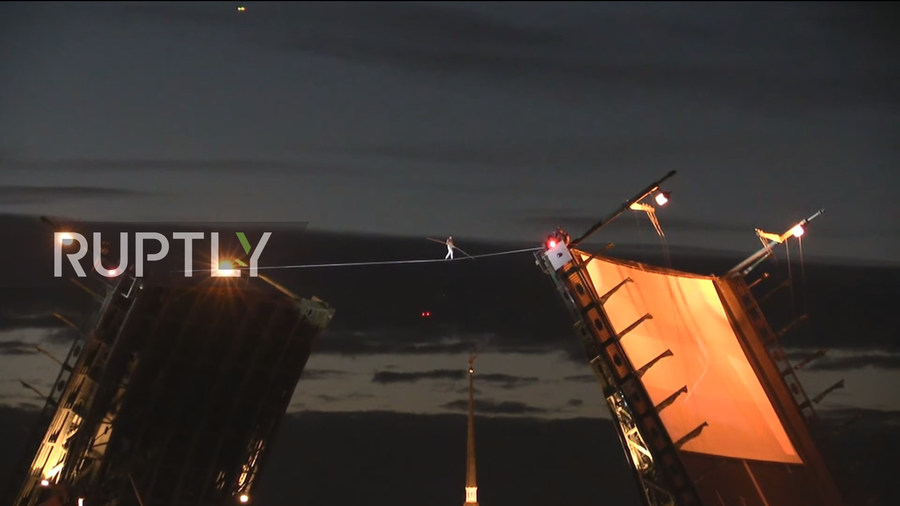 Russian tightrope walker stuns St. Petersburg as he crosses Neva River over open bridge (VIDEO)