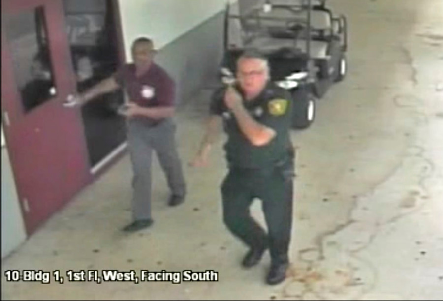 Father of Parkland school shooting victim sues 'coward' cop