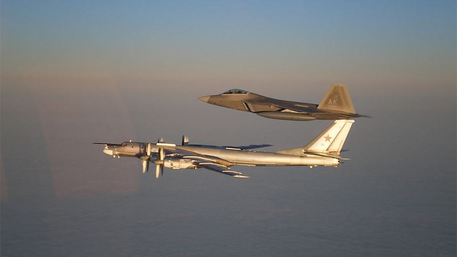 Russian strategic bombers escorted by US F-22 over neutral Arctic waters – MoD