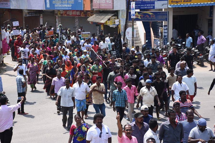 Demonstrators march to collectors office during a protest demanding the closure of a copper factory in Tuticorin