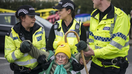 Anti-fracking activist Anne Power, 81, is removed by police during protest © Steven Speed