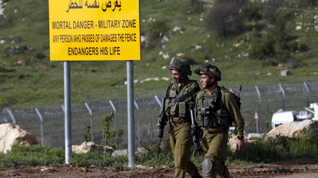 FILE PHOTO: Israeli soldiers walk near the frontier with Syria near Majdel Shams in the Golan Heights © Baz Ratner