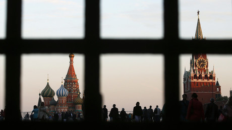 Red Square, St. Basil's Cathedral (L) and the Spasskaya Tower of the Kremlin are seen through a gate in central Moscow, September 18, 2014. © Maxim Zmeyev