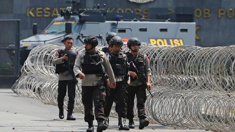 Police patrol outside the prison in Depok, south of Jakarta. © Beawiharta
