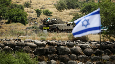 An Israeli tank in the Israeli-occupied Golan Heights © Amir Cohen