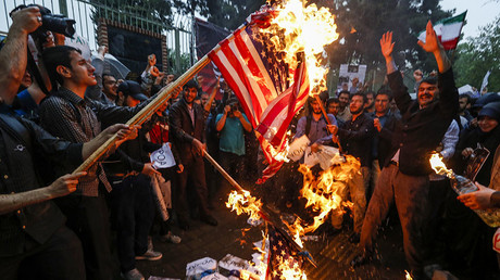 Iranians burn US flags during an anti-US demonstration outside the former US embassy headquarters in the capital Tehran on May 9, 2018. © Atta Kenare