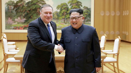 FILE PHOTO: North Korean leader Kim Jong Un shakes hands with US Secretary of State Mike Pompeo © KCNA