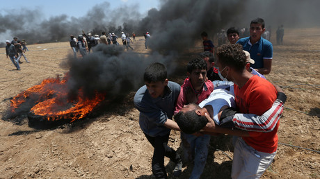 A wounded Palestinian demonstrator is evacuated during Gaza protest.  Abu Mustafa