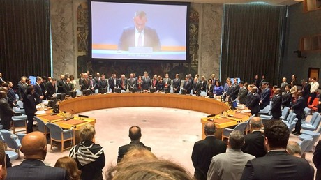 Members of the UN Security Council stand for a minute's silence for the victims of Mondfay's violence on the Gaza border.
