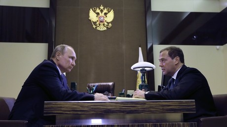 Vladimir Putin and Dmitry Medvedev discuss government reforms in Sochi on Tuesday.