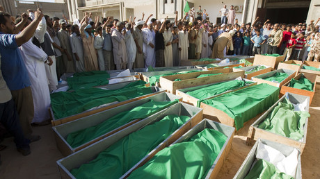 Coffins of 28 people, who Libyan government officials say were killed by NATO air strikes, August 9, 2011. © Caren Firouz