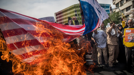 Iranians burn a US flag during a protest against President Trump's decision to pull out of the nuclear deal. © Reuters