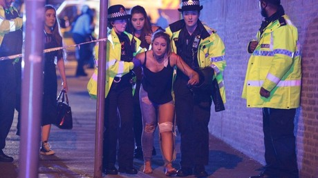 FILE PHOTO: An injured concert-goer is helped by police and emergency responders at the Manchester Arena after the explosion. © Joel Goodman / Global Look Press