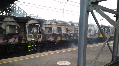 Blazing train pulling into station sparks panic (PHOTOS, VIDEOS)