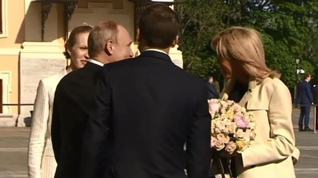He did it again: Putin gives flowers to French first lady (VIDEO)