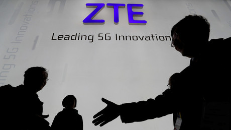 Visitors in front of the ZTE Corp booth at the Mobile World Congress in Barcelona, Spain, February 26, 2018. © Yves Herman