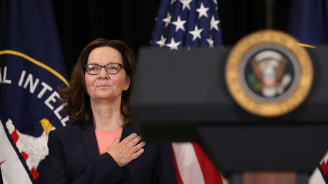 New CIA Director Gina Haspel holds her hand over her heart for the US National Anthem, May 21, 2018. © Kevin Lamarque