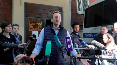 [Redacted] speaks with journalists outside a court building in Moscow © Tatyana Makeyeva