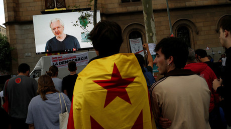 Julian Assange addressing people in Barcelona via a live video link. © Jon Nazca