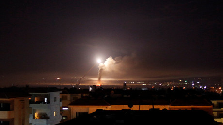 FILE PHOTO: Missile fire is seen from Damascus © Omar Sanadiki