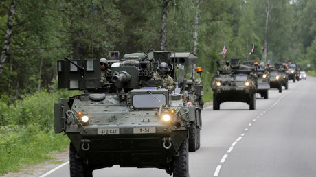 U.S. troops drive during tactical road march Dragoon Ride II near Daugavpils, Latvia, June 6, 2016. © Ints Kalnins