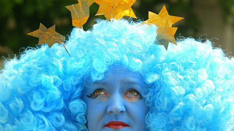 A woman dressed as a representation of the EU (European Union) flag attends carnival in Dublin © Peter Macdiarmid