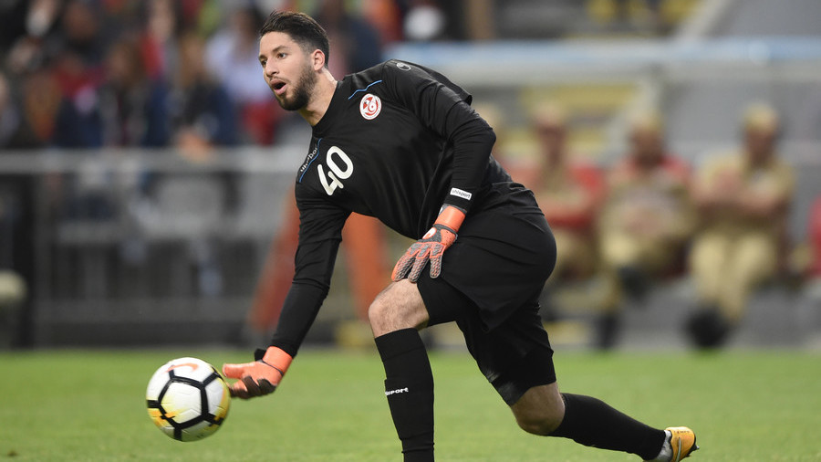 tunisia goalkeeper fakes injury to allow players to break ramadan