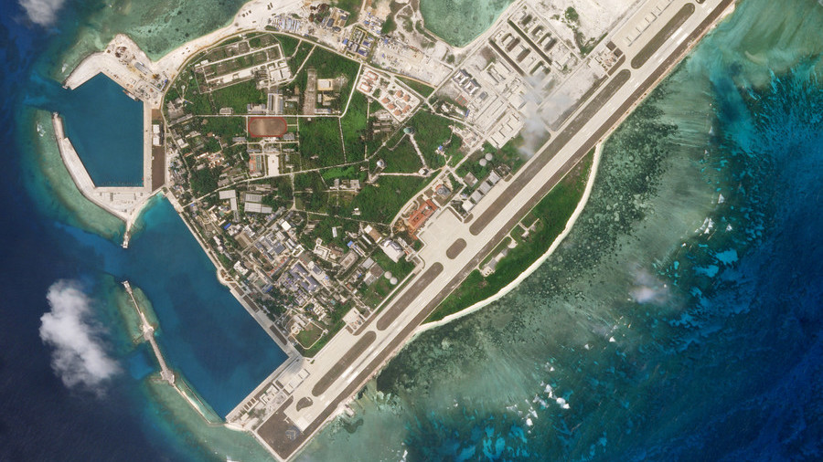 China redeploys missile systems on disputed South China Sea island (SATELLITE PHOTOS)