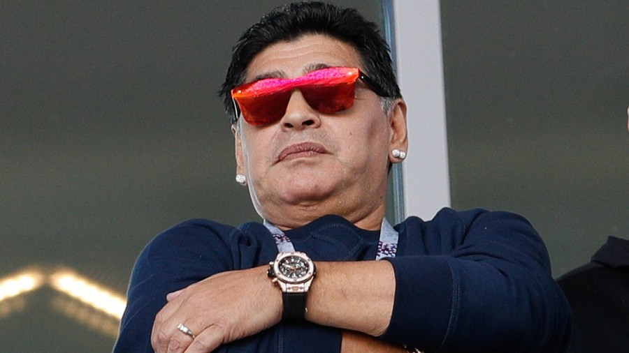 Maradona denies making racist gesture at S. Korean World Cup fans, apologizes for puffing on cigar