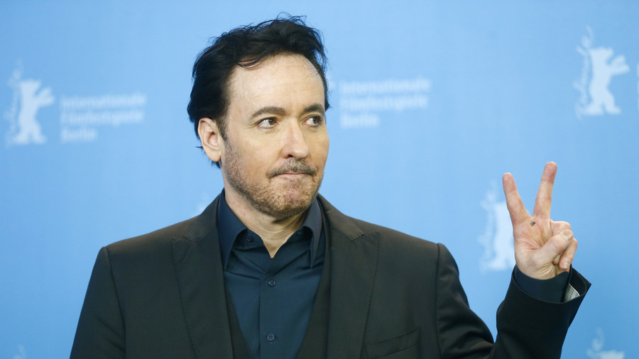 John Cusack accused of inciting violence for 'burn it down' tweet during immigration rant