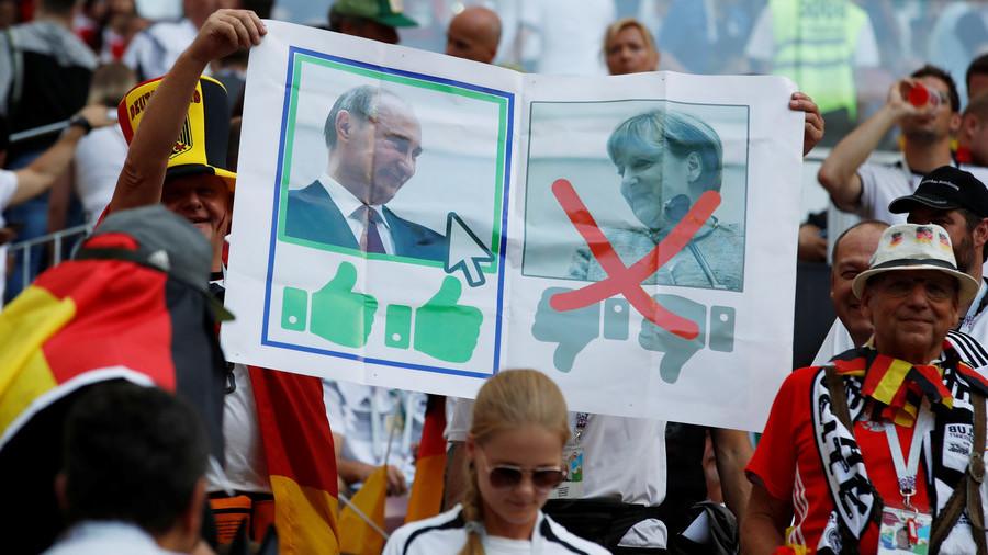 'Da Putin, Nein Merkel' – banner seen at Germany-Mexico match