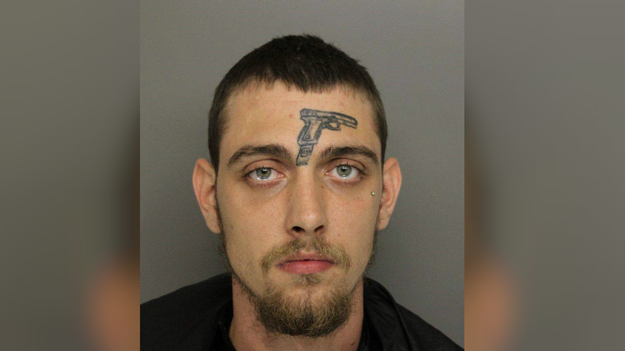 Self-fulfilling prophecy? Man with gun tattoo on face arrested for firearm possession (PHOTO)