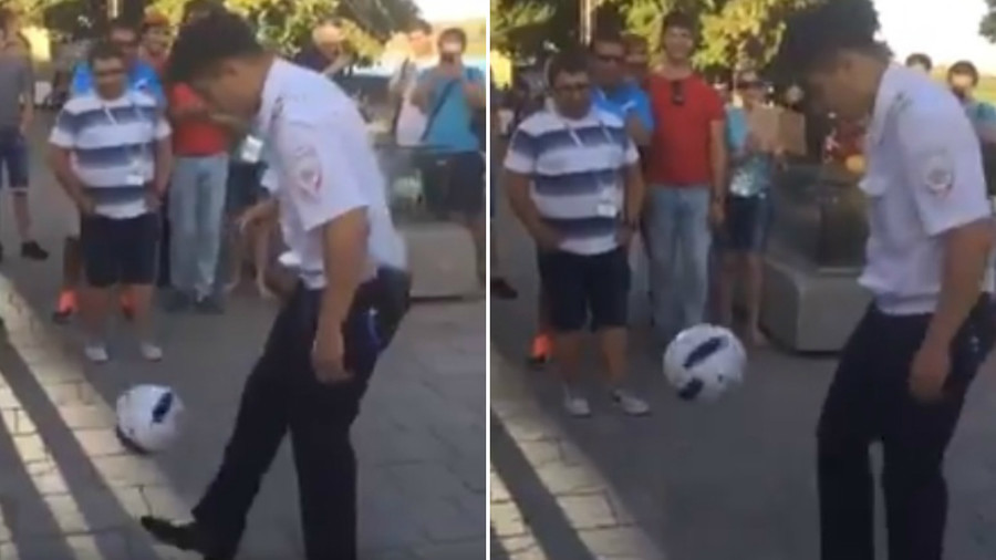 Russian police officer wows fans with football juggling skills (VIDEO)