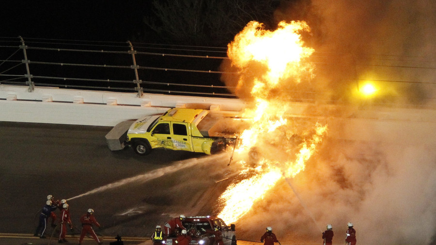 Dramatic rescue: Father pulls son from burning race auto