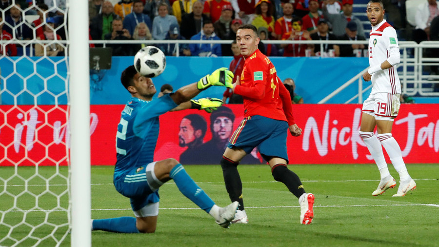 Spain set up last 16 clash with Russia after grabbing late draw against eliminated Morocco