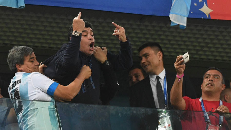 Maradona flips off crowd after Rojo winner sees Argentina through to last 16