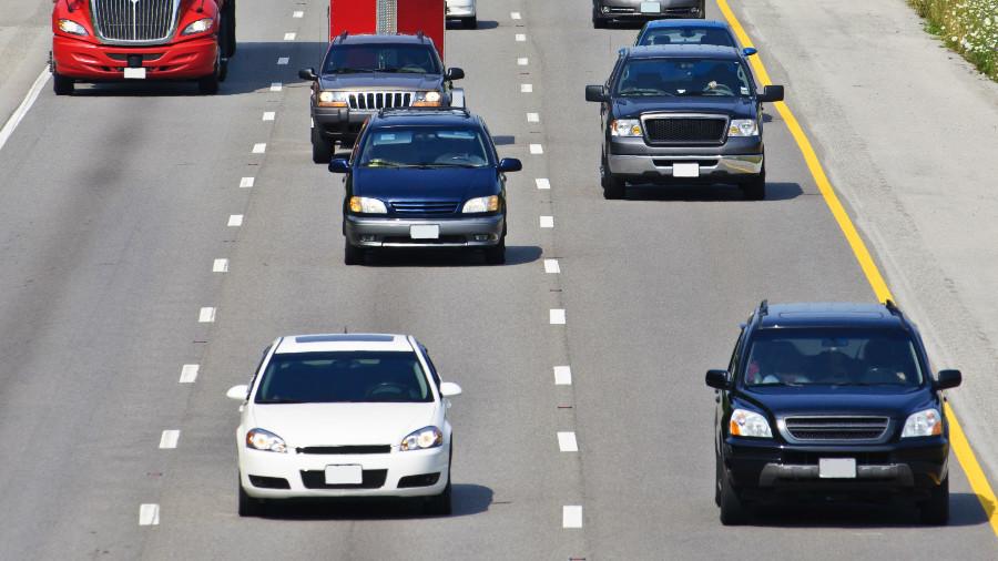 Man in vest dangles on hood of car speeding down Florida highway (VIDEO)
