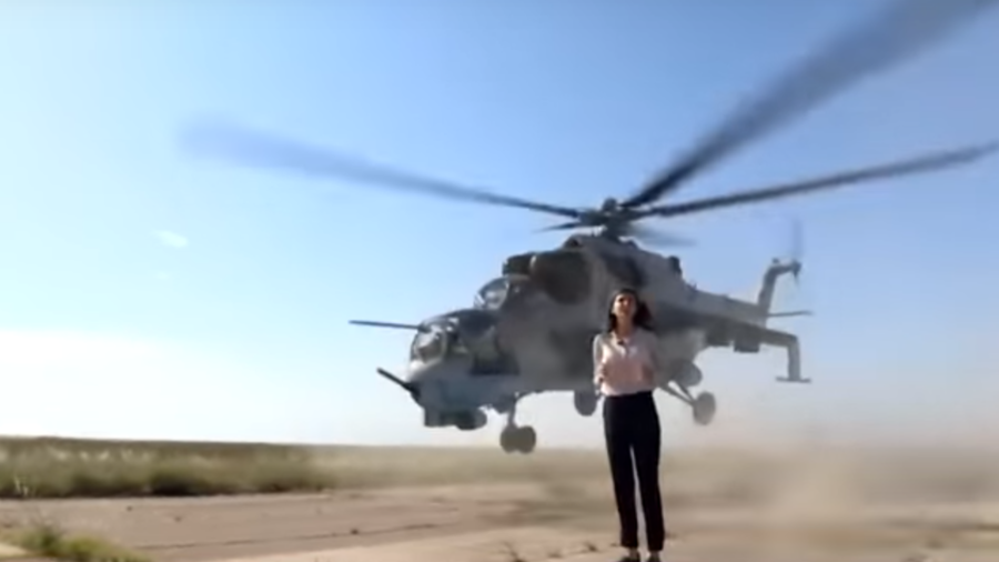 Hack avoids chop: Reporter risks decapitation when promoting army helicopters (VIDEO)