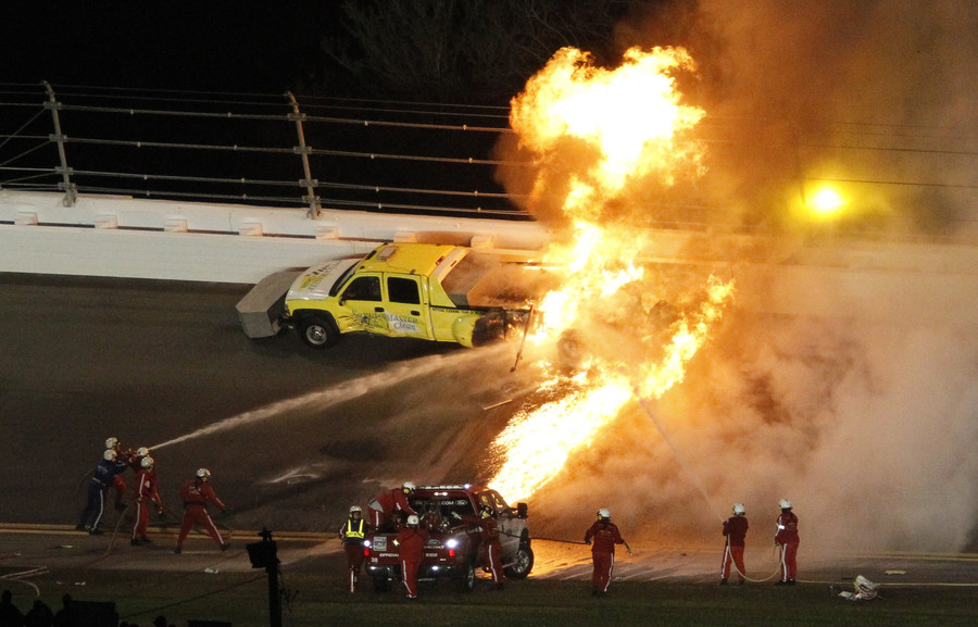 Dramatic rescue: Father pulls son from burning race car (VIDEO)