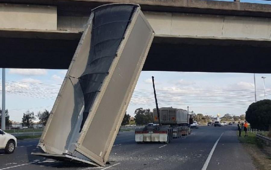 Barely-believable highway collision sees dump truck plow into bridge (VIDEO)