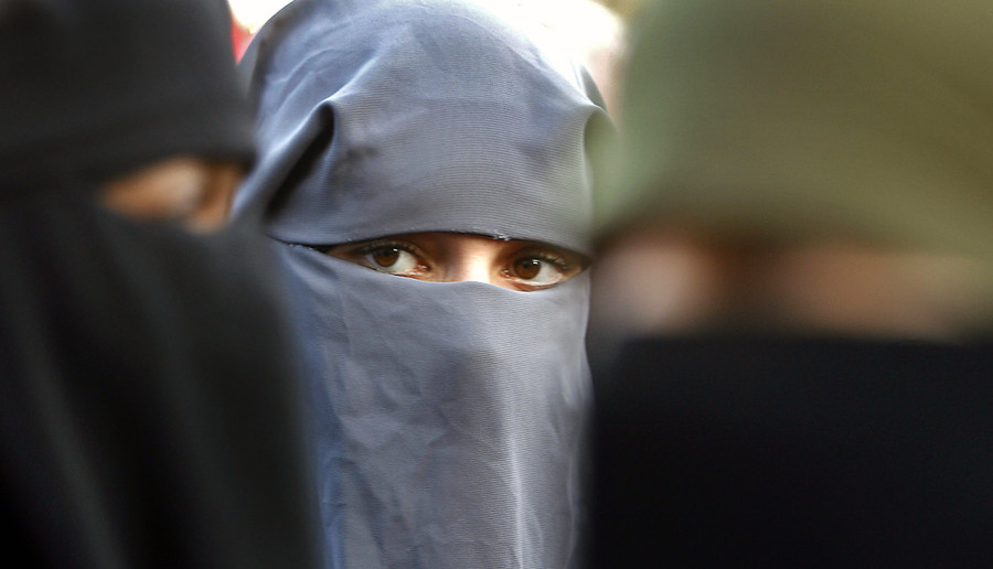 Islamic face veils banned in public buildings by Dutch parliament