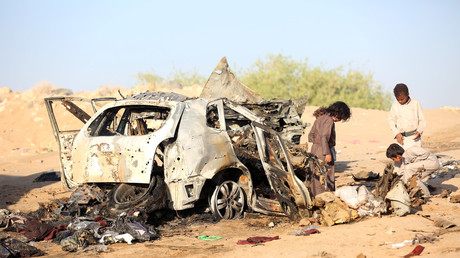 Boys inspect the wreckage of a car hit by a drone air strike in Yemen last year © Ali Owidha
