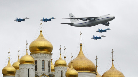 A Russian military Antonov An-124 transport aircraft flies in formation with fighter jets over Red Square and the Kremlin ©  Natallia Ablazhei