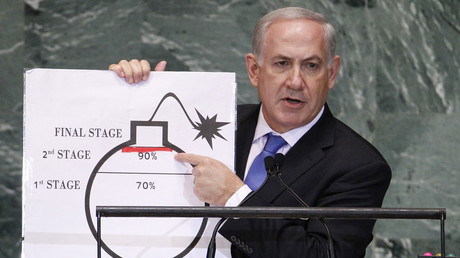 Israel's PM Benjamin Netanyahu points to a red line he has drawn on the graphic of a bomb as he addresses the 67th UNGA at the UN Headquarters in New York, September 27, 2012.