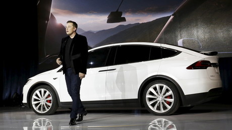 Elon Musk keeps grip on Tesla, promises to solve production problems