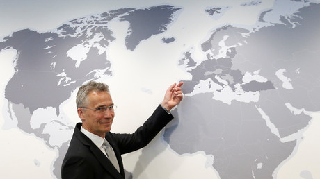 NATO Secretary-General Jens Stoltenberg poses next to a world map, Brussels, Belgium, May 7, 2018 © Francois Lenoir