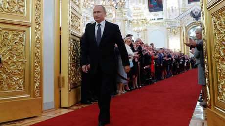 Vladimir Putin walks before an inauguration ceremony at the Kremlin in Moscow, Russia May 7, 2018.
