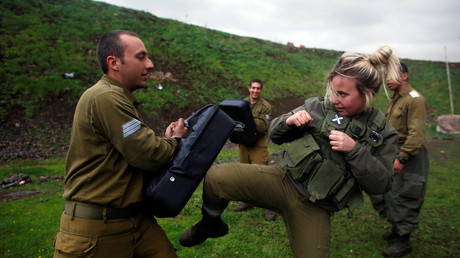 A female Israeli soldier from the Haraam artillery battalion takes part in a training session in Krav Maga, an Israeli self-defence technique © Nir Elias